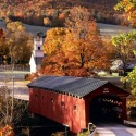 Country Road and old covered bridge in Autumn