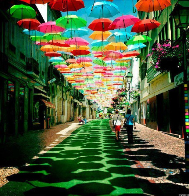 Floating umbrella installation in the streets of Águeda , Portugal
