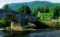 Arch Bridge and Moss Covered House, Wales, England