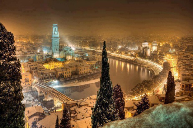 Winters night over the town of Verona in Italy